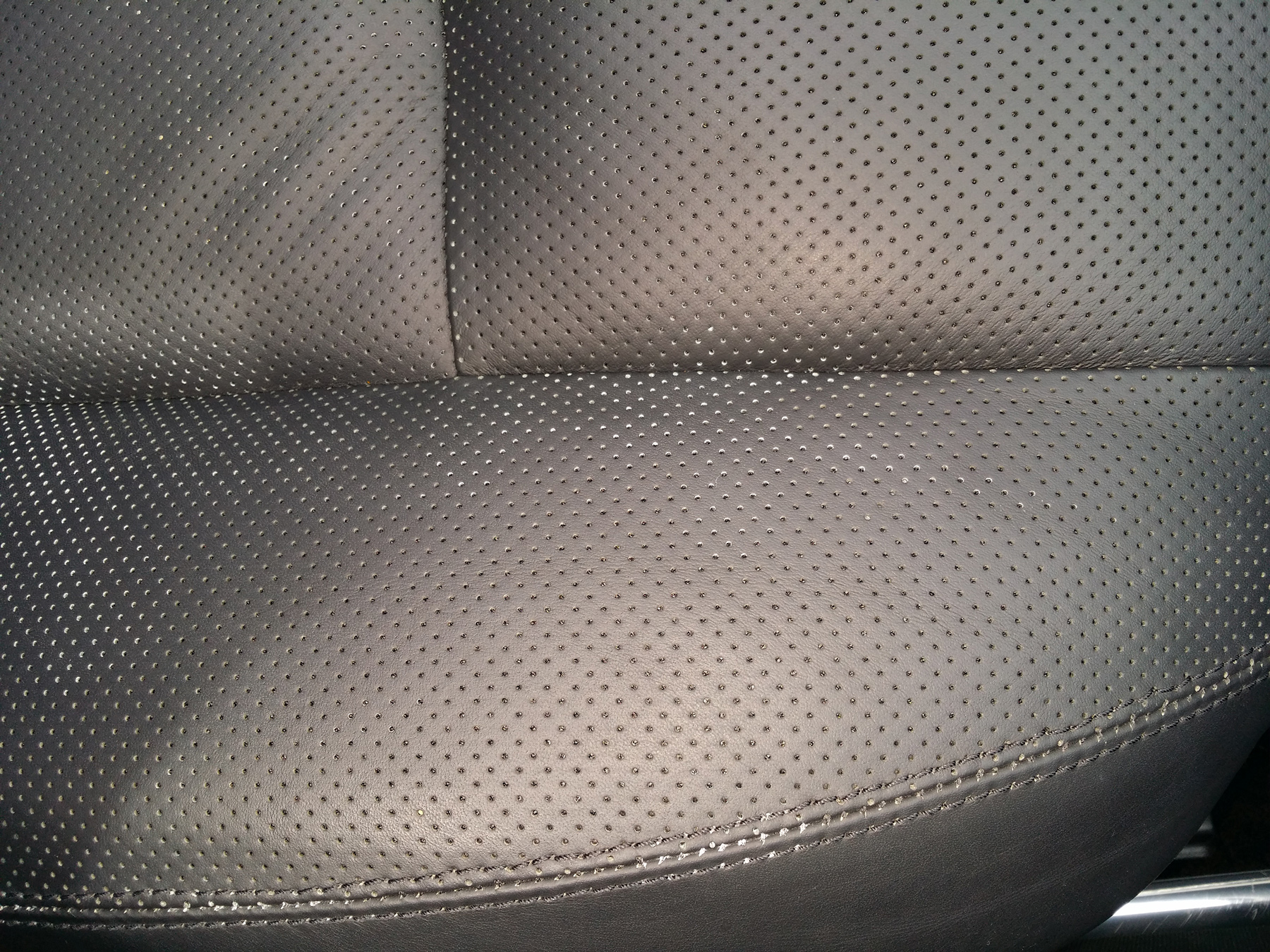 Name:  CL550_PASSENGER_White in perfs_sew holes streched.jpg Views: 102 Size:  1.35 MB
